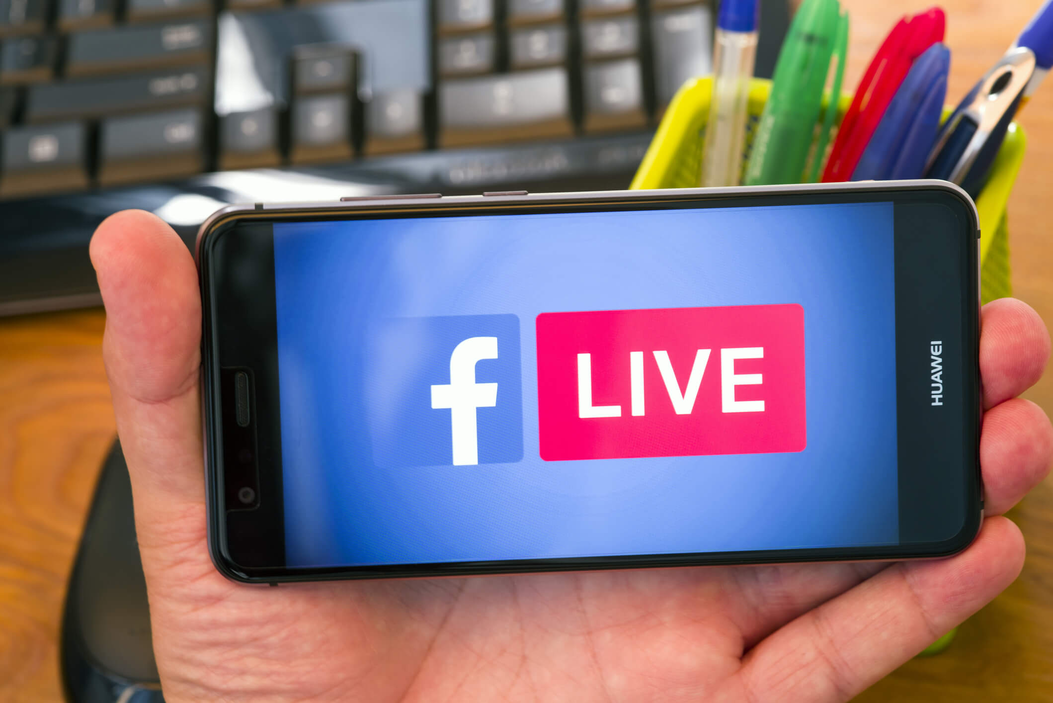 Facebook Live logo on a mobile phone screen